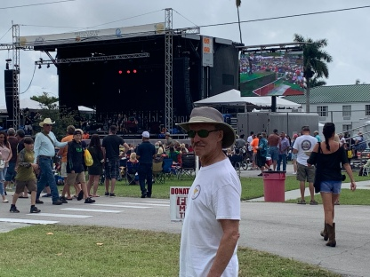 The arena at the Clewiston Sugar Festival blared country western music.
